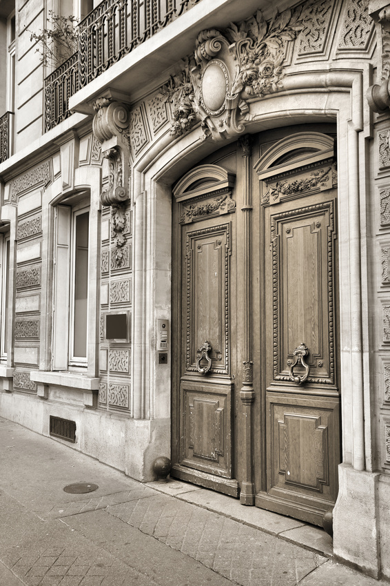 Paris, France - typical old apartment building. Wooden door.